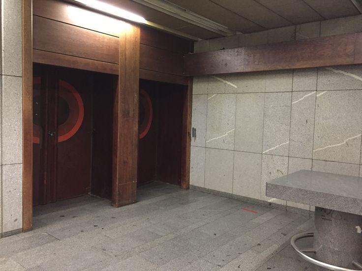 Phoneless telephone booth corner: abandoned at Praha-Holesovice railway station