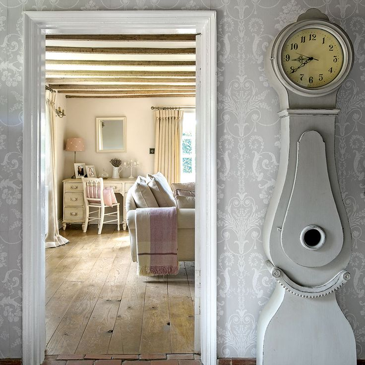 Classic hallway with grey damask wallpaper and painted clock