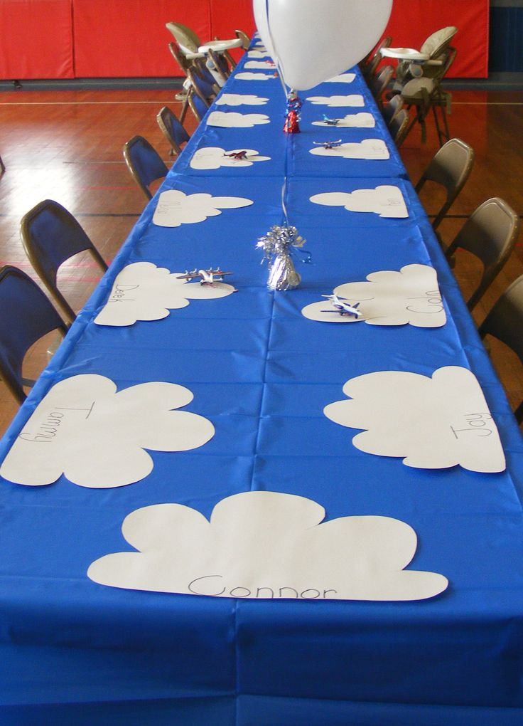 Airplanes need a place to land, so here's a kids table with clouds. Each child gets a Mat Box plane with a banner and there's a control tower! | Trains, Planes, and Big Rigs Party