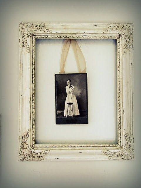 Just hang different photos in old frame, doesn't matter the size of photo.