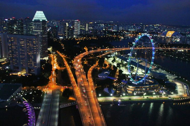 The city of Singapore, Singapore Flyer and buildings panorama from the top of level 56 at Marina Bay Sands