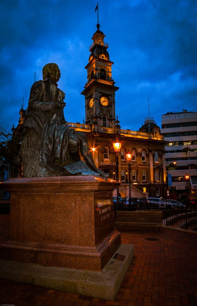 The Octagon, Dunedin with Robbie Burns statue and the Town Hall behind by Bill McPhail