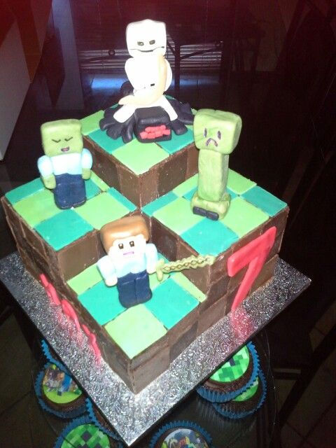 Minecraft cake- chocolate cake with tinted chocolate squares and gumpaste figurines