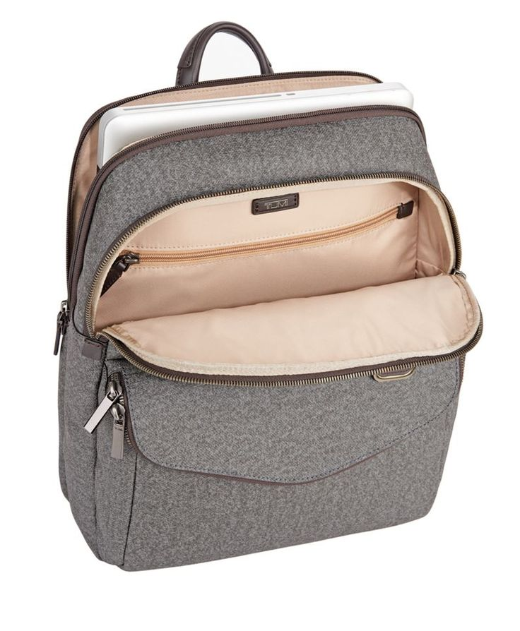 Sophisticated. Simple. Elegantly detailed. Sinclair is a modern collection of thoughtfully designed totes, briefs, carry-alls and accessories for women. Crafted from an exceptionally durable fabric, this stylish backpack is beautifully designed for work, school or hands-free weekend outings.