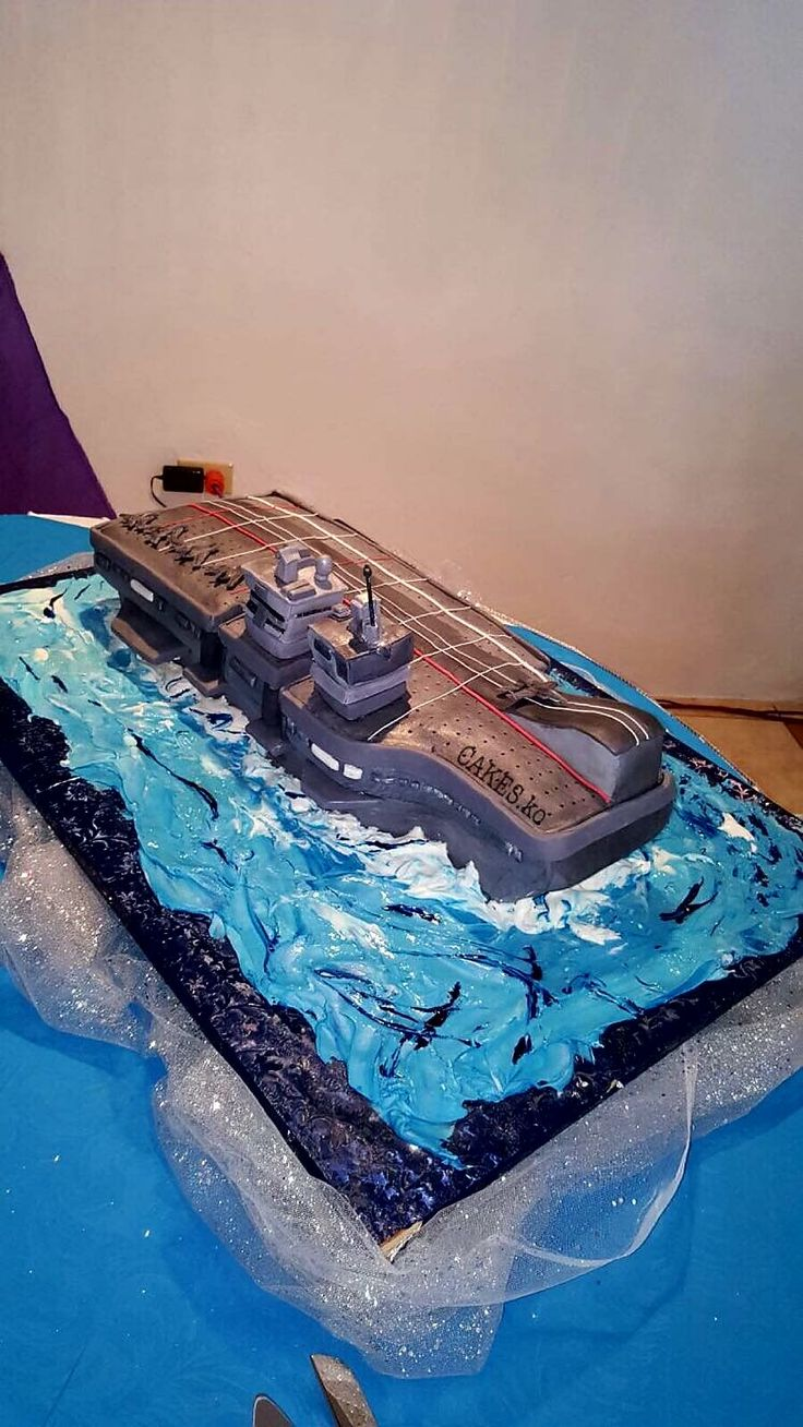 Made this Vanilla sponge navy ship on rough waters for the groomsman. Click link to my business page for more of my work.