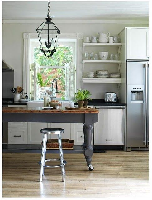 I like the color of this island with the butcher block top.
