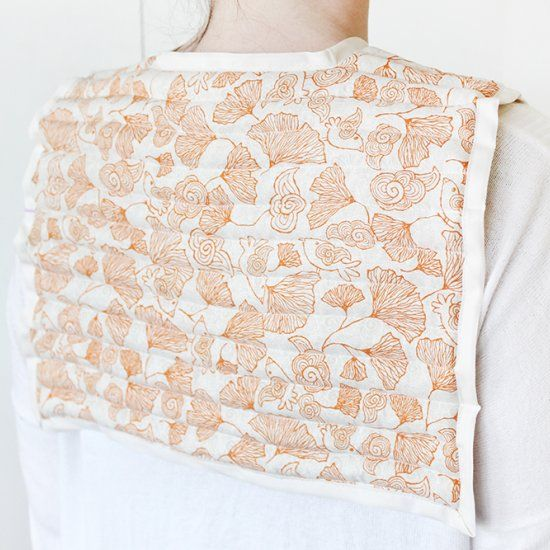 This rice-filled shoulder heating pad lays right over your shoulders so you can microwave it and relax anytime.