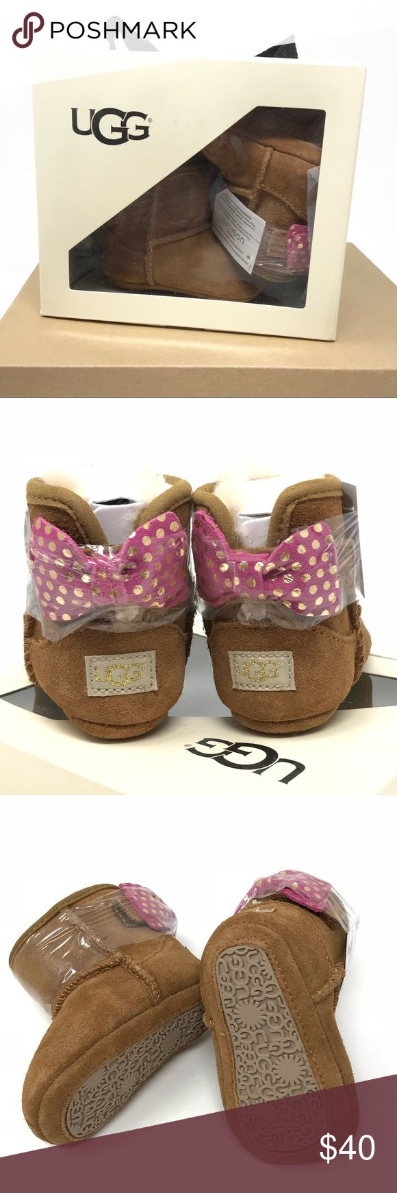 Baby UGG 'Jesse II Bow Boot' (0 - 6 months) Adorable grosgrain-ribbon bows accent an ultrasoft suede bootie that will keep your little one's feet warm and toasty.   🔹Soft, cozy lining is made from plush UGGpure, a textile made entirely from wool but engineered to feel and 🔹Velcro back closure 🔹Suede upper/UGGpure wool lining/rubber sole 🔹Raving reviews! sold out at Nordstrom  🚫Trades UGG Shoes Baby & Walker