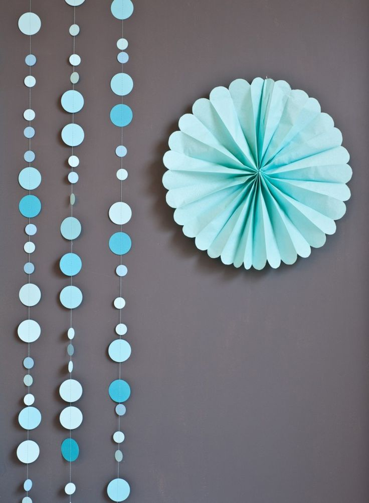 Sewn circle garland design aspects: two sizes of circles, shades of one color, pattern to the sequence