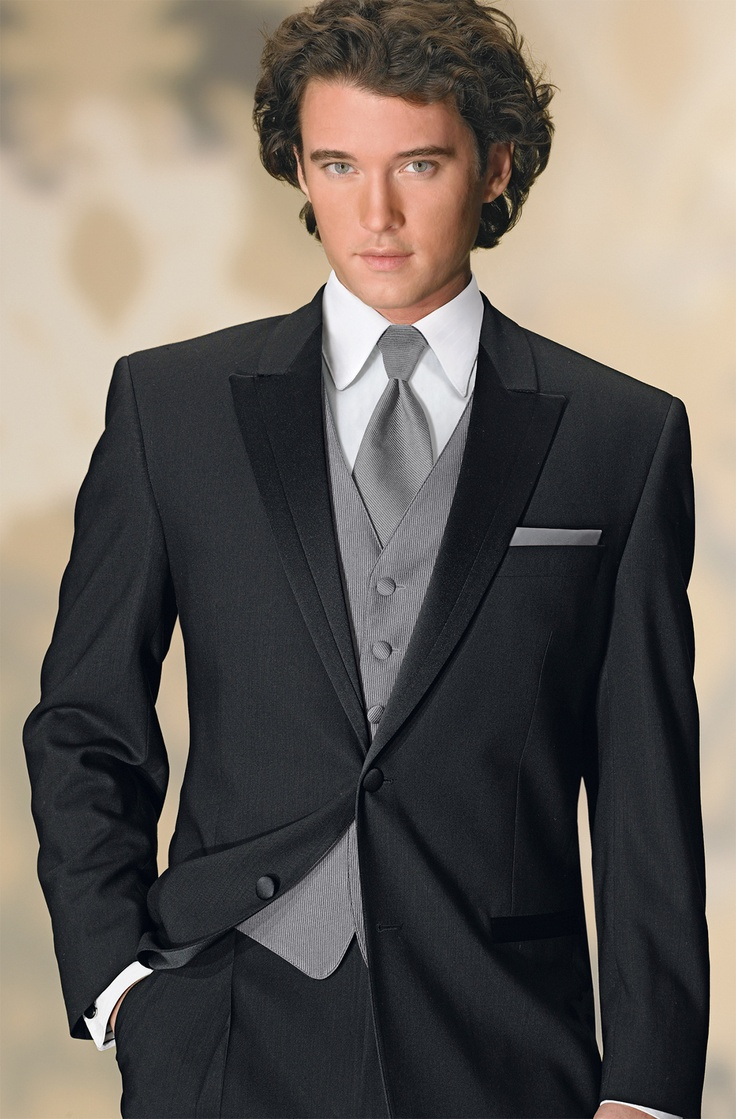 I like the silver vest and tie look