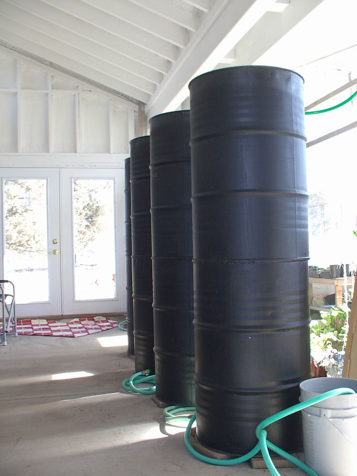 These barrels collect water off the roof where it heats up warming the greenhouse in the winter.
