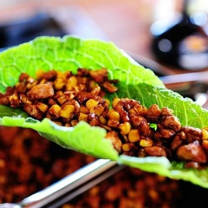 Looks like a yummy lettuce wrap, made with tofu, soy sauce & corn.