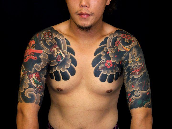 Asian Short Sleeve And Chest Tattoo