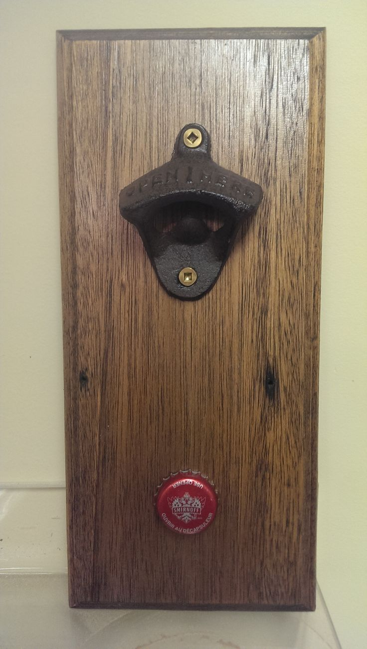 Reclaimed solid oak, planed and stained with dark walnut stain. Cast iron bottle opener with magnetic bottle cap catcher.