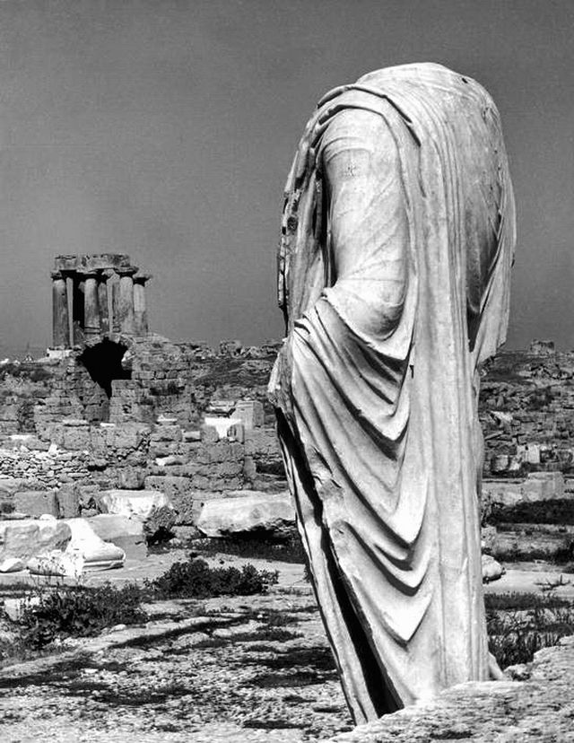 Corinth, Peloponnese Greece 1937. Statue and Temple of Apollo in the background - Herbert List.