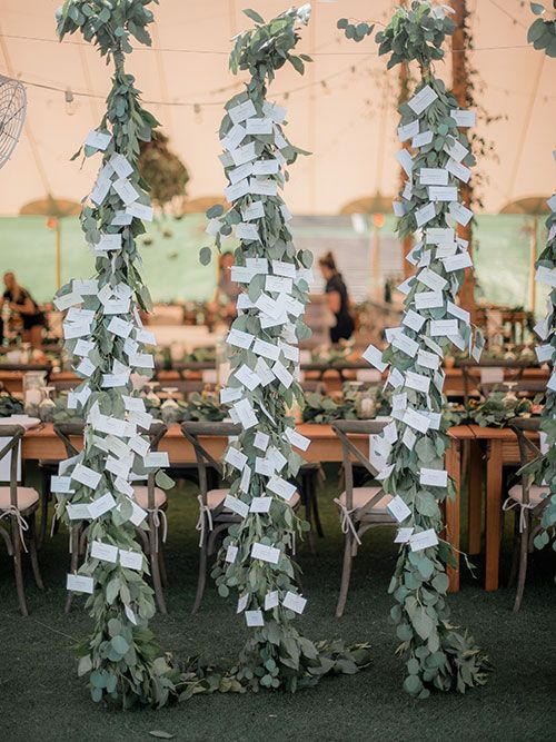 Outdoor South Carolina Wedding Inspired by Nature, Escort Cards Hung on Greenery Garlands