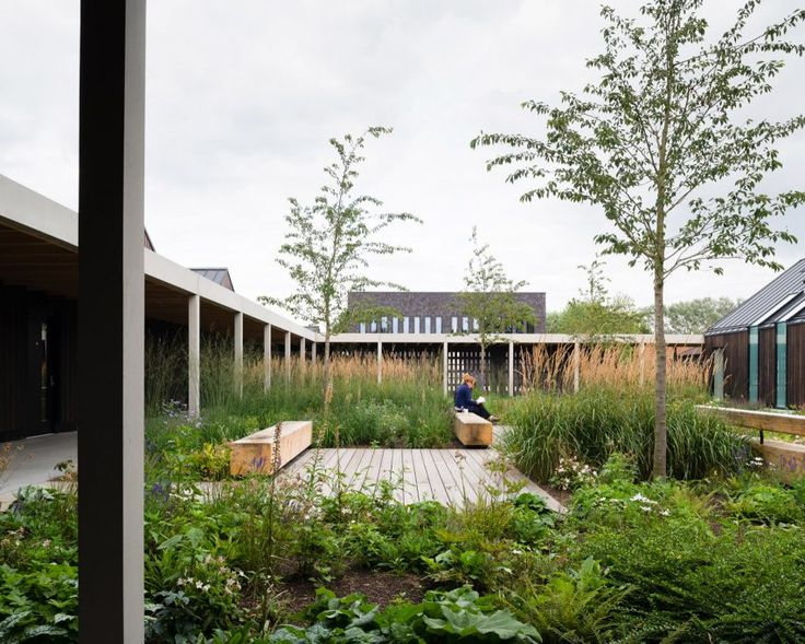 This Buddhist retreat by Walters & Cohen Architects features a cluster of pitched-roof structures arranged around tranquil courtyards in the English countryside.
