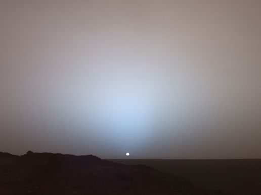 "sunset on mars - ""On May 19, 2005, NASA's Mars Exploration Rover Spirit captured this stunning view as the Sun sank below the rim of Gusev crater on Mars. This Panoramic Camera mosaic was taken around 6:07 in the evening of the rover's 489th Martian day, or sol."""