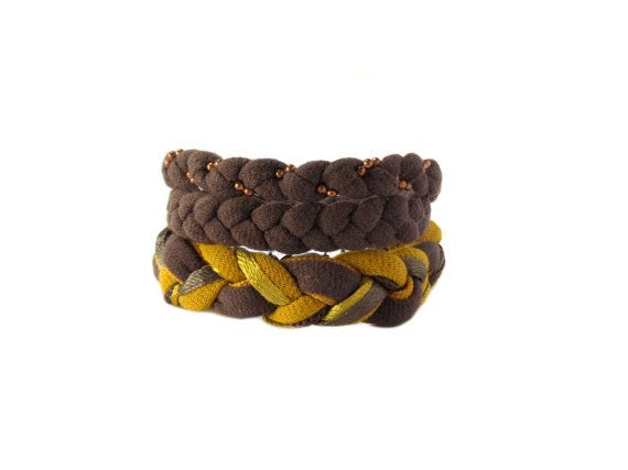 Handmade brown bracelets made from cotton t-shirt yarn, satin ribbons, and a copper ball chain.