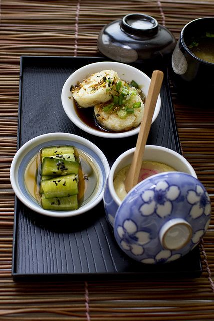 Japanese side dishes - pickled cucumbers, agadeshi tofu, chawan mushi (egg custard), and miso soup.