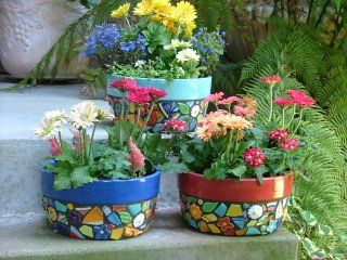 Mosaic terra-cotta pots.  These colorful ones look great with simple multicolor zinnias.