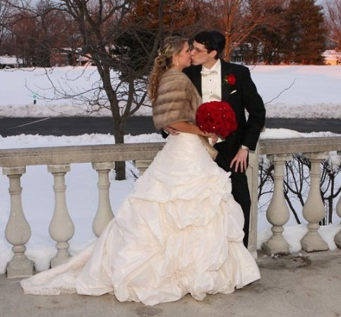 Wedding Style - Winter Wedding . Dress ( Maggie Sottero Sabelle in Ivory ) fur stole (vintage) Flowers ( 50 + black magic roses w/ crystals in between)