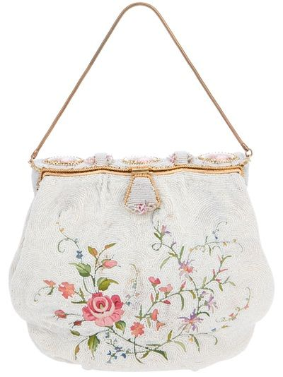 White beaded bag from Rewind Vintage Affairs featuring an all-over bead and embroidery design, a front hinge fastening and a chain handle.