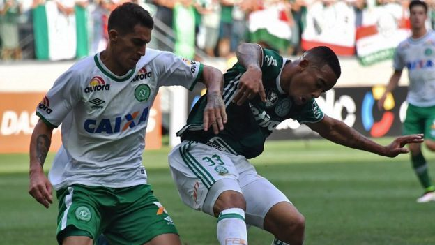 Palmeiras' player Gabriel Jesus vies for the ball with Gimenez of Chapecoense during their Brazilian Championship football match on 27 November
