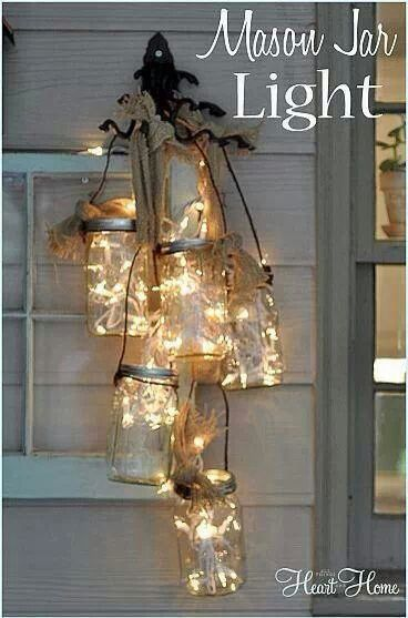 Cluster of mason jar lights. Put a strand of christmas lights in and out of the mason jars. (HeartBunch, Etsy)
