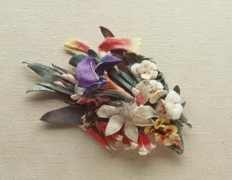 Brooch, Australian wildflowers, painted kid leather / wool, made by Lucie Dalgarno, Sydney, NSW, 1920-1930. Friends used to give her their old kid gloves, and she used photographic tinting inks to colour the kid.
