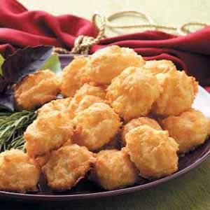 "Cheese Puffs Recipe -""I found this recipe in one of my mother's old cookbooks and updated the flavor by adding cayenne and mustard,"" recalls Jamie Wetter of Boscobel, Wisconsin. ""Tasty and quick for this busy season, these tender, golden puffs go together in minutes and simply disappear at parties!"""