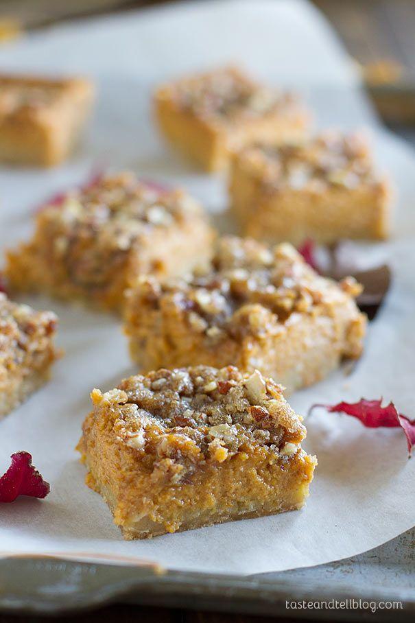 Pumpkin Pie Bars Recipe - An easy oat crust is topped with a creamy pumpkin filling and a sugary topping in these holiday worthy bars.