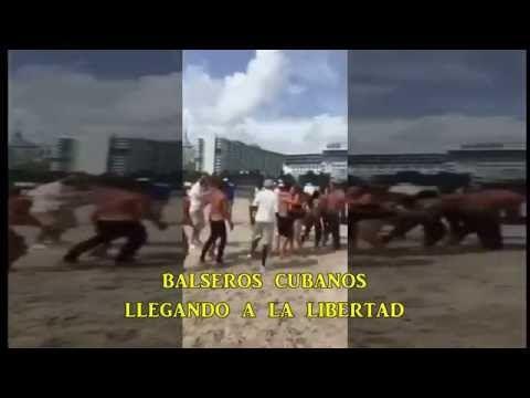 balseros cubanos  llegando a la libertad .