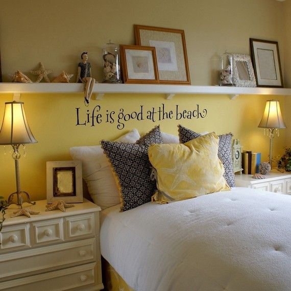 Love the shelf above the bed instead of a headboard