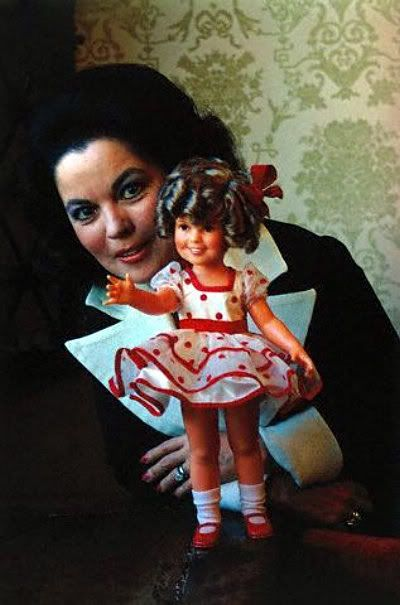 Shirley Temple and one of the many dolls imaged after her.....I wanted that doll soooo much when I was small! I still do want one!!