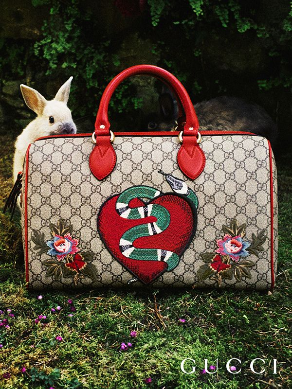 Discover more gifts from the Gucci Garden. A limited edition top handle bag crafted in GG motif and appliquéd with a heart, snake and floral motifs by Alessandro Michele.