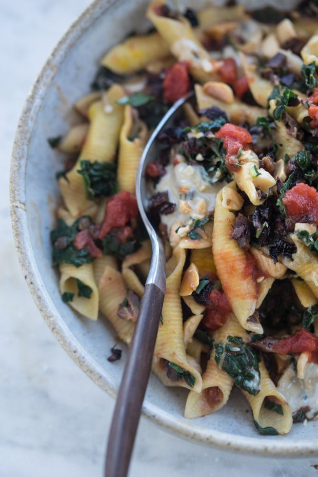 An Excellent, One-pan, Protein-packed Power Pasta - pasta and lentils simmered in crushed tomatoes, finished with lots of chopped kale, saffron, swirls of tahini and chopped almonds.