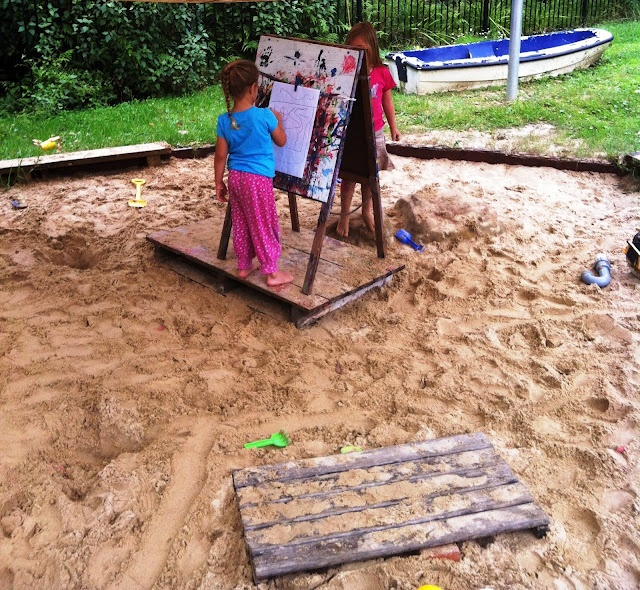 The easel was moved to the sandpit to draw maps - or whatever else took their fancy.