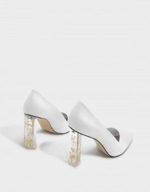 2e8a26b77c White Floral Lucite Heel Pumps | CHARLES & KEITH | story boards ...