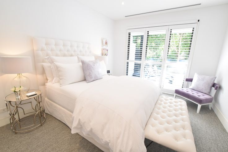 Warm tones and luxurious bedding compliments the Andrew Loader Design customer bedhead
