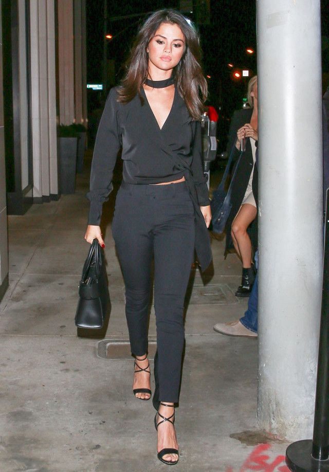 On Selena Gomez: Uniqlo top (sold out); AYR The Arrow Pants in Black ($185); Brian Atwood heels; Givenchy Horizon Grained Calfskin Leather Tote ($2690).