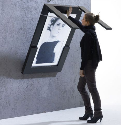 I want this table-cum-picture frame. Great space-saving idea for urban living.