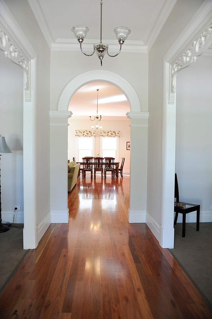 Victorian cove cornices,Timber Fretwork to openings and solid brass door handles add imense charm to the interiors