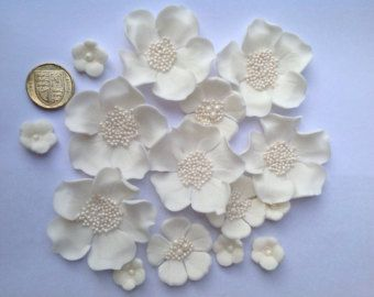 15 edible sugarpaste wedding cake flowers in ivory, white or cream.  Also ideal as celebration cupcake toppers, birthday cake decoration