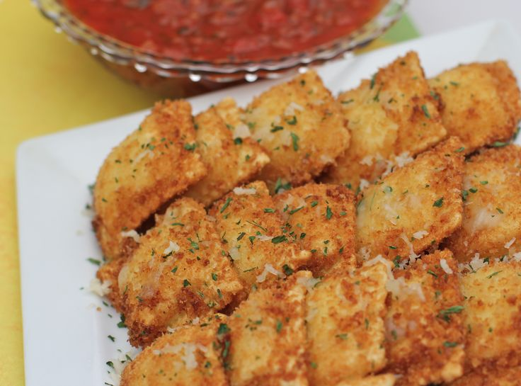 Toasted Ravioli Appetizers ---------- Ravioli that is dipped and coated with bread crumbs, then fried or baked. Serve warm with marinara sauce.