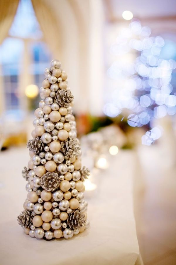 Pine cones and baubles in gold and silver make beautiful centrepieces • How to have a fabulously festive Christmas wedding by niedn