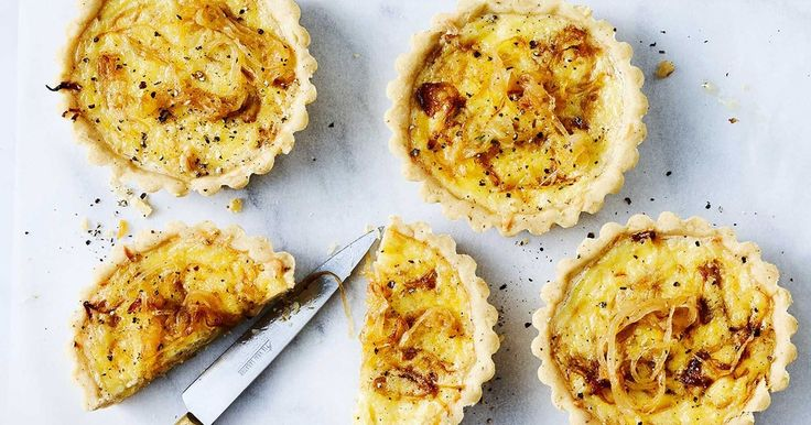 With a buttery thyme pastry, these cheddar and caramelised onion tarts make for delicious finger food.