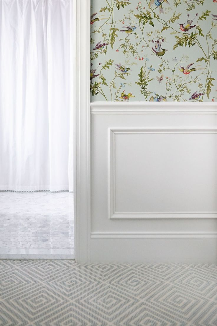 Classic Little Girl's Room with white half wall wainscoting and floral wallpaper designed by SHOPHOUSE Interior Designers. Geometric Carpet by Stark. Cole and Son Hummingbirds wallpaper. Hexagon Marble Bathroom tile. www.shophousedesign.com
