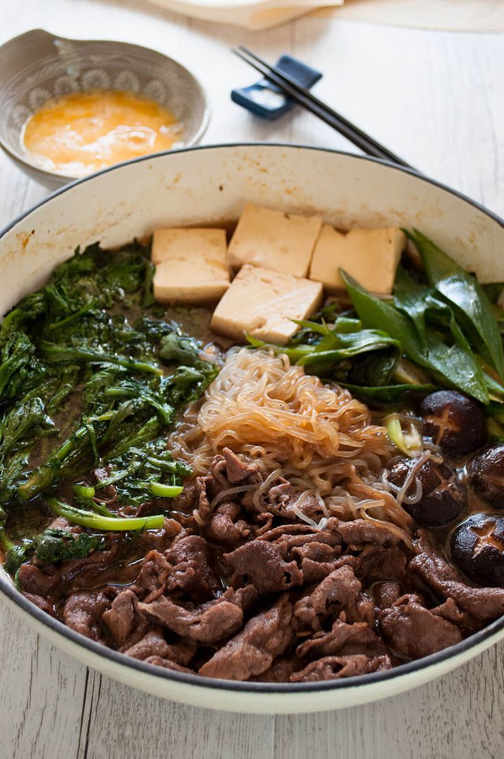 Sukiyaki - thinly sliced beef, tofu and vegetables in sweet soy sauce flavour cooked at the table is so much fun. It is easy to make and so yummy.