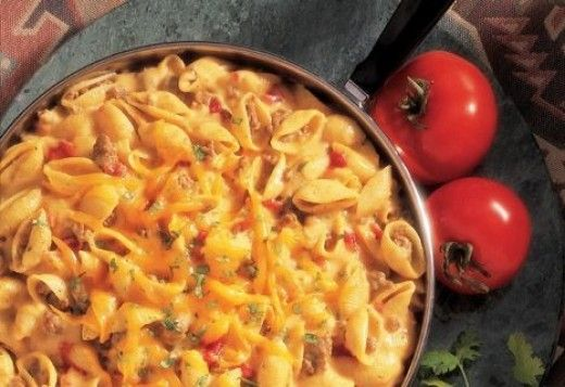 Spicy Venison Pasta and Cheese  1 lb grnd venison 1 can Beef Broth 1 1/3 cups water 2 cups uncooked medium shell-shaped pasta 1 can Condensed Cheddar Soup 1 cup Picante Sauce 1.Cook the venison in a skillet over med-high heat til well browned, stirr often. Pour off fat. 2.Stir in broth and waterand heat to a boil. add pasta. Reduce heat to med. Cook for 10 minutes or until the pasta is tender, stirring often. 3.Stir in the soup and picante sauce and cook until the mixture is hot and bubbling